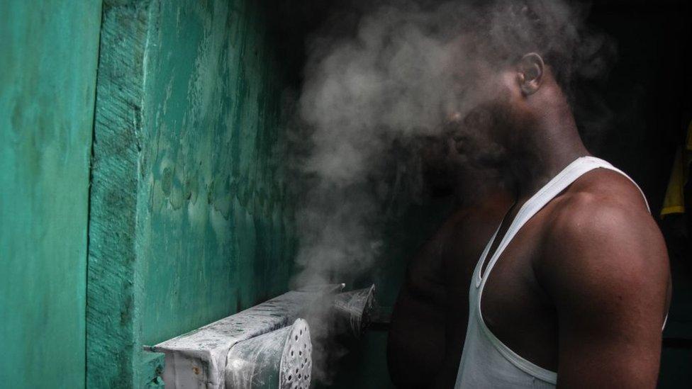 Man inhaling steam in Tanzania
