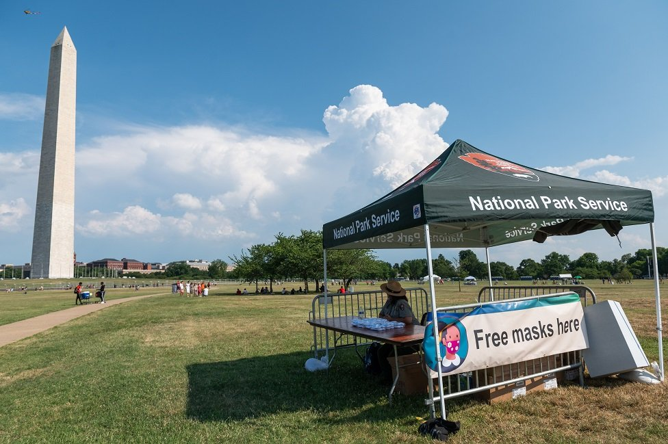 The US National Park Service offers free masks on the National Mall in Washington, DC, ahead of the July 4, 2020, Independence Day celebrations.