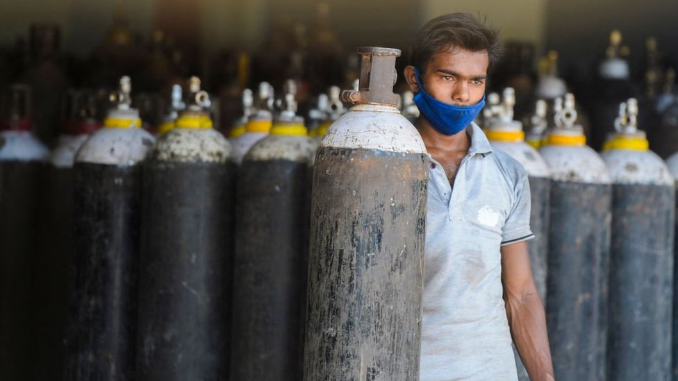 A worker arranges medical oxygen cylinders to transport to hospitals for the Covid-19 coronavirus treatment in a facility on the outskirts of Hyderabad on April 23, 2021.