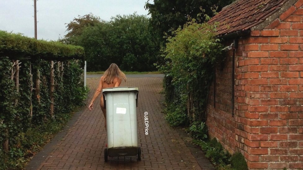 British naturist Donna Price taking the bin out from home