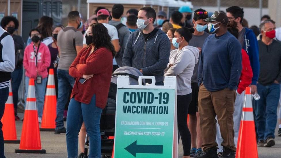People queue in a line to get the COVID-19 Vaccine in Miami, Florida, 5 April 2021