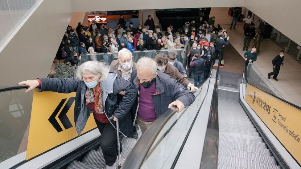 People queuing up for vaccination at a shopping centre in Belgrade
