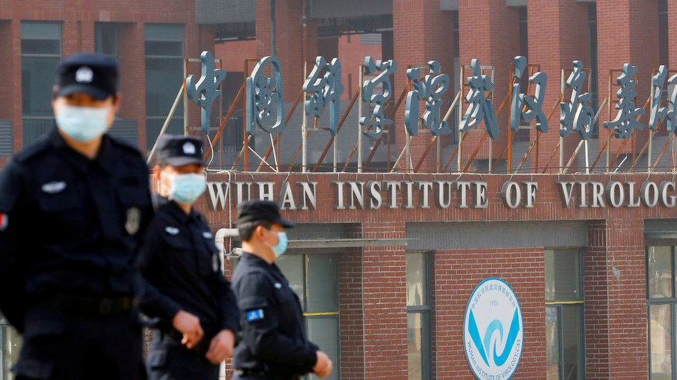Security personnel outside the Wuhan Institute of Virology during the visit by WHO team, Feb 2021