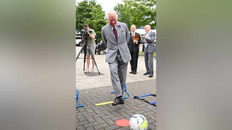 Prince Charles takes aim and shoots