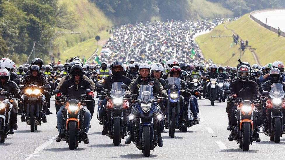 A handout photo made available by the Presidency of Brazil that shows the Brazilian President, Jair Bolsonaro (C), during a motorcycle tour with his followers, in Sao Paulo, Brazil, 12 June 2021.